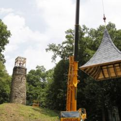 The roof of the restored bell tower at Akron Rural Cemetery, more commonly known as Glendale Cemetery, is lifted into place Tuesday in Akron. The bell tower was restored over the spring and early summer by Stan Hywet Hall & Gardens subsidiary ARRC Inc. who managed the project.